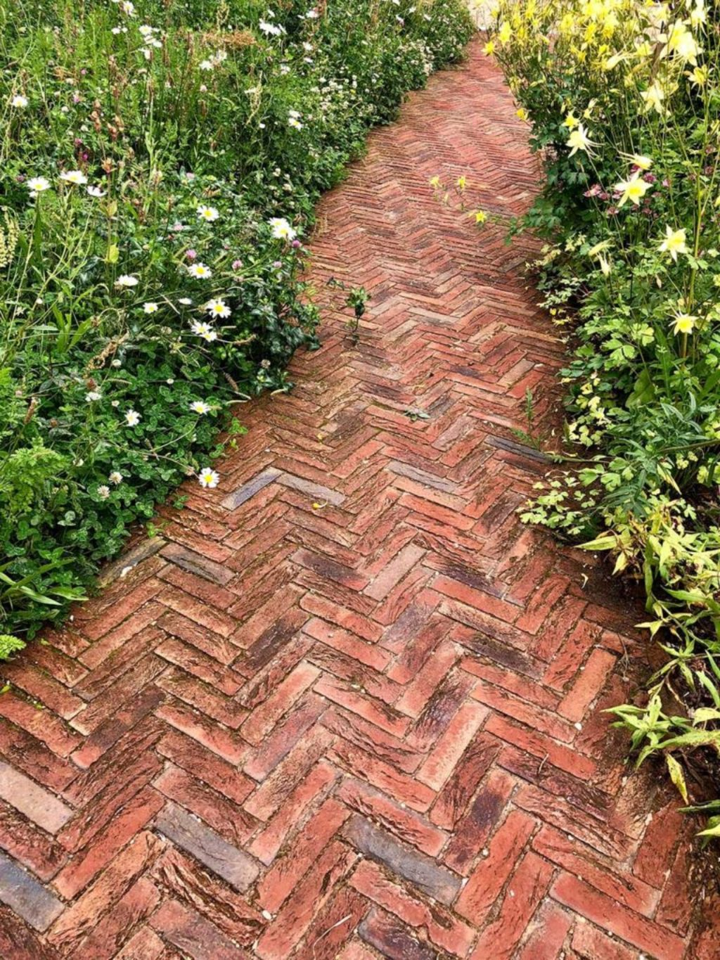 Clay Pavers Laid In Herringbone Pattern